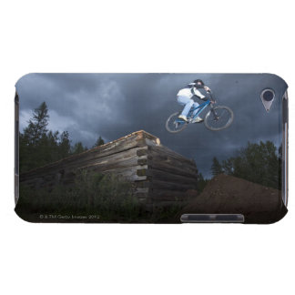 A mountain biker jumps off a log cabin in Idaho. iPod Touch Cover