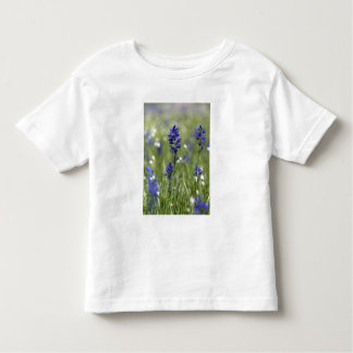 A mountain meadow of wildflowers including toddler T-Shirt
