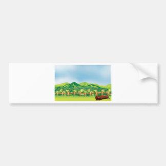 A mountain view across a wooden fence bumper sticker