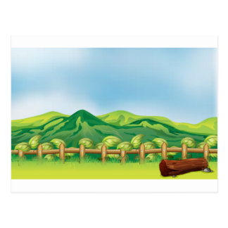 A mountain view across a wooden fence postcard