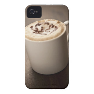 A mug of Cappuccino coffee topped with melted iPhone 4 Cases