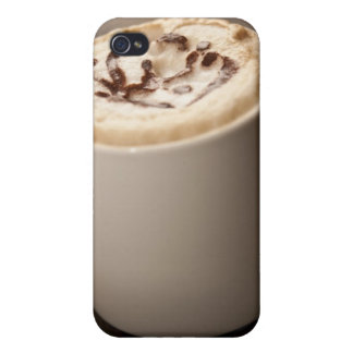 A mug of Cappuccino coffee topped with melted Cover For iPhone 4