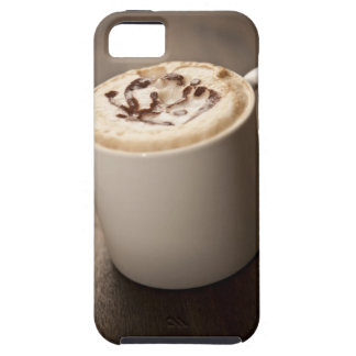 A mug of Cappuccino coffee topped with melted iPhone 5 Case