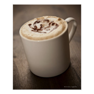 A mug of Cappuccino coffee topped with melted Poster