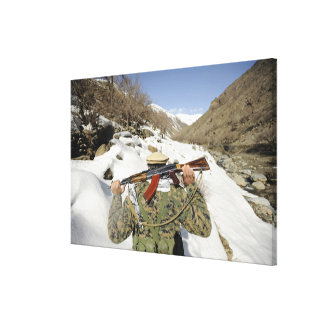 A Mujahadeen Guard walks with US Military membe Canvas Print
