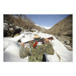 A Mujahadeen Guard walks with US Military membe Photo