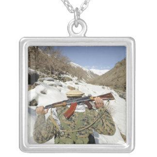 A Mujahadeen Guard walks with US Military membe Silver Plated Necklace