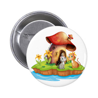 A mushroom house with two cats 6 cm round badge