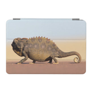 A Namaqua Chameleon walking across a sandy plain iPad Mini Cover