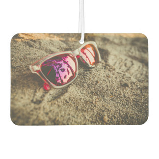 A Pair Of Fashionable Sunglasses On The Beach Car Air Freshener