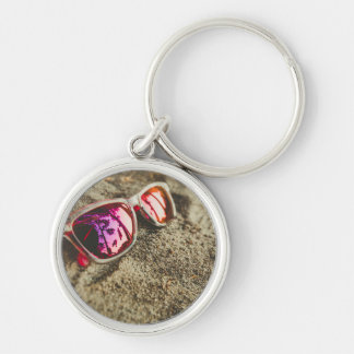 A Pair Of Fashionable Sunglasses On The Beach Silver-Colored Round Key Ring