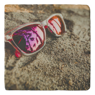 A Pair Of Fashionable Sunglasses On The Beach Trivets