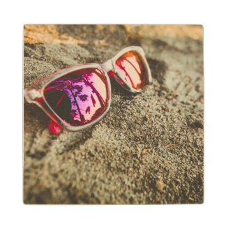 A Pair Of Fashionable Sunglasses On The Beach Wood Coaster