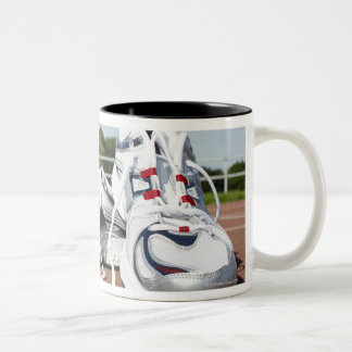 A pair of new white running trainers are placed Two-Tone mug