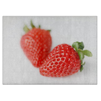 A Pair of Red Strawberries Cutting Board