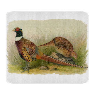 A pair of Ring necked pheasants in a grassy field Cutting Board
