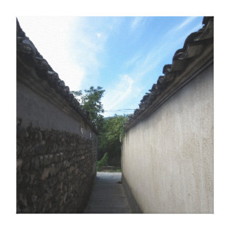 A path between two walls towards the sky stretched canvas prints