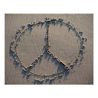 A peace sign drawn in the sand.