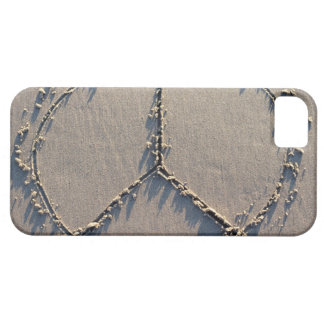 A peace sign drawn in the sand. iPhone 5 covers