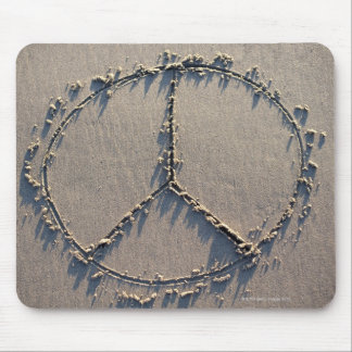 A peace sign drawn in the sand. mouse mat