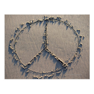 A peace sign drawn in the sand. postcard