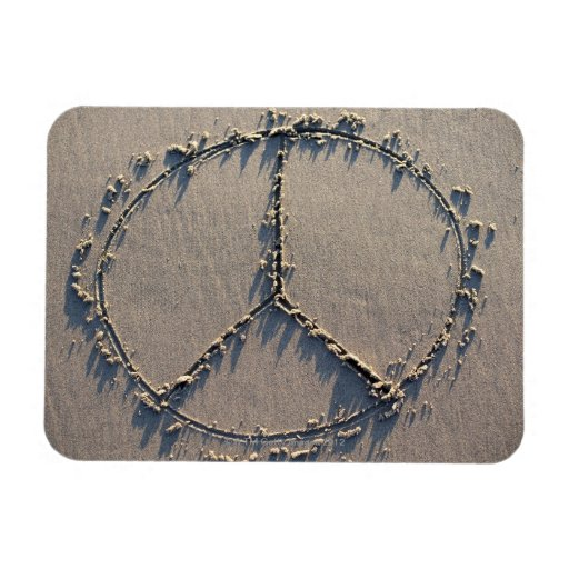A peace sign drawn in the sand. magnets