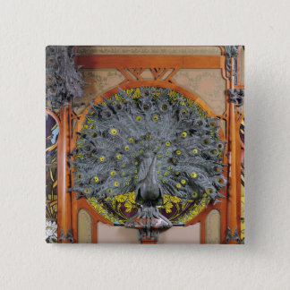 A peacock from the central panel of a mural 15 cm square badge
