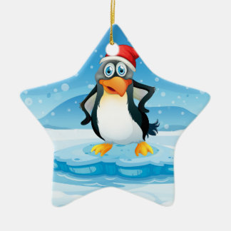 A penguin wearing Santa's hat standing above an ic Christmas Ornament