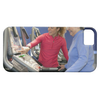 A personal trainer helps a senior woman on a barely there iPhone 5 case