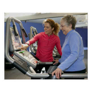 A personal trainer helps a senior woman on a poster
