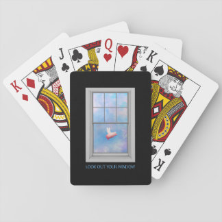 A pig flying past-look out your window playing cards