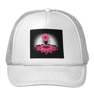 A Pink Flower on Black Background Trucker Hat