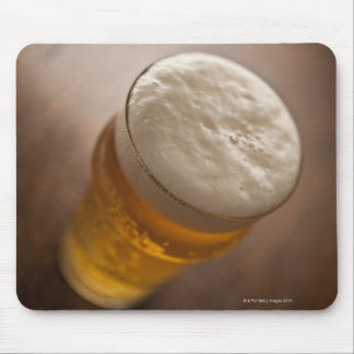 A pint of lager, back lir shallow focus rustic mouse mat