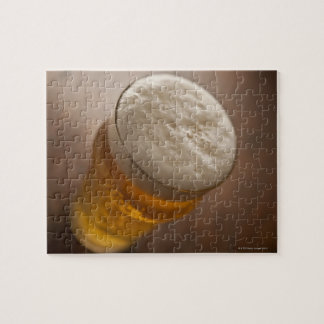 A pint of lager, back lir shallow focus rustic puzzles