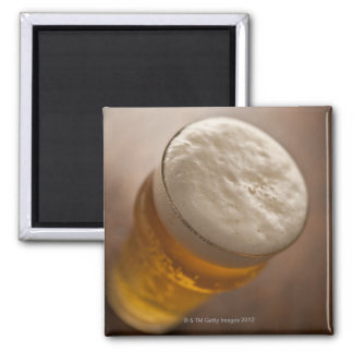 A pint of lager, back lir shallow focus rustic square magnet