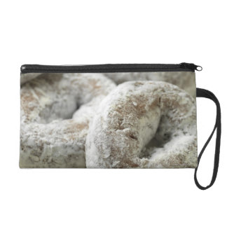 A plate of sugar donuts wristlet purse