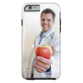 A portrait of a doctor holding a . tough iPhone 6 case