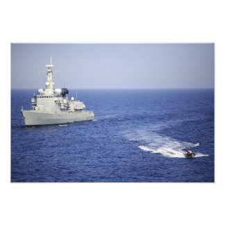 A Portuguese navy team in an inflatable boat Photo Print