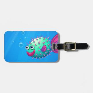 A puffer fish smiling bag tag