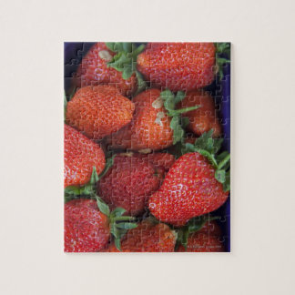 a punnet of ripe fresh strawberries for sale in jigsaw puzzle