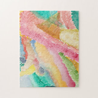A puzzle with an abstract watercolored design