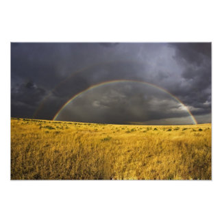 A rainbow appearing through a misty after noon photo print