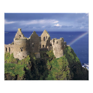 A rainbow strikes medieval Dunluce Castle on Photo Print