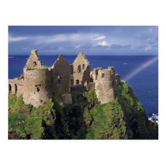 A rainbow strikes medieval Dunluce Castle on Postcard