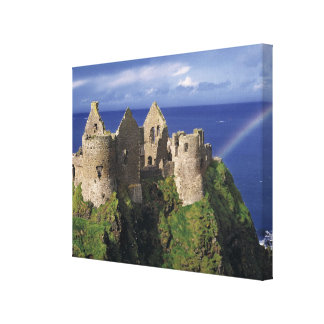 A rainbow strikes medieval Dunluce Castle on Stretched Canvas Prints