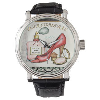 A Red Shoe, A Bottle of Perfume, and Blush Powder Watch