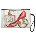 A Red Shoe, A Bottle of Perfume, and Blush Powder Wristlet