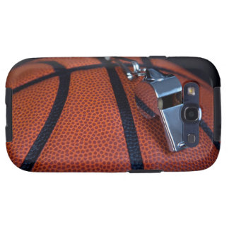 A referee's whistle rests on top of a galaxy SIII case