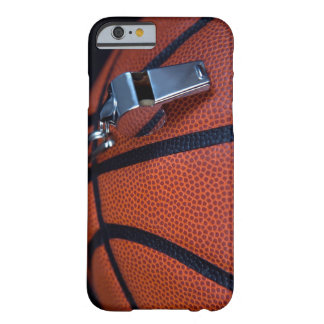 A referee's whistle rests on top of a barely there iPhone 6 case