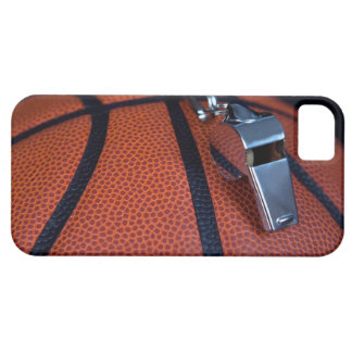 A referee's whistle rests on top of a iPhone 5 case